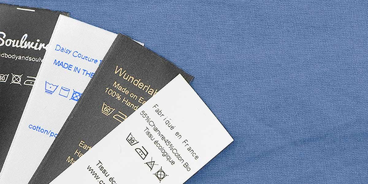 Una tecnica professionale di cucito: le etichette di manutenzione e composizione